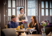 guests chatting to waitress Maldron Hotel Grain and Grill restaurant